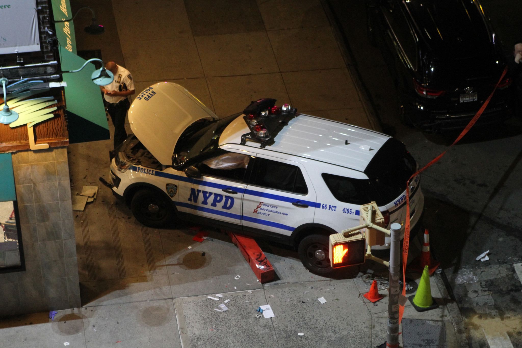 Five hurt when NYPD car slams storefront in Brooklyn crash