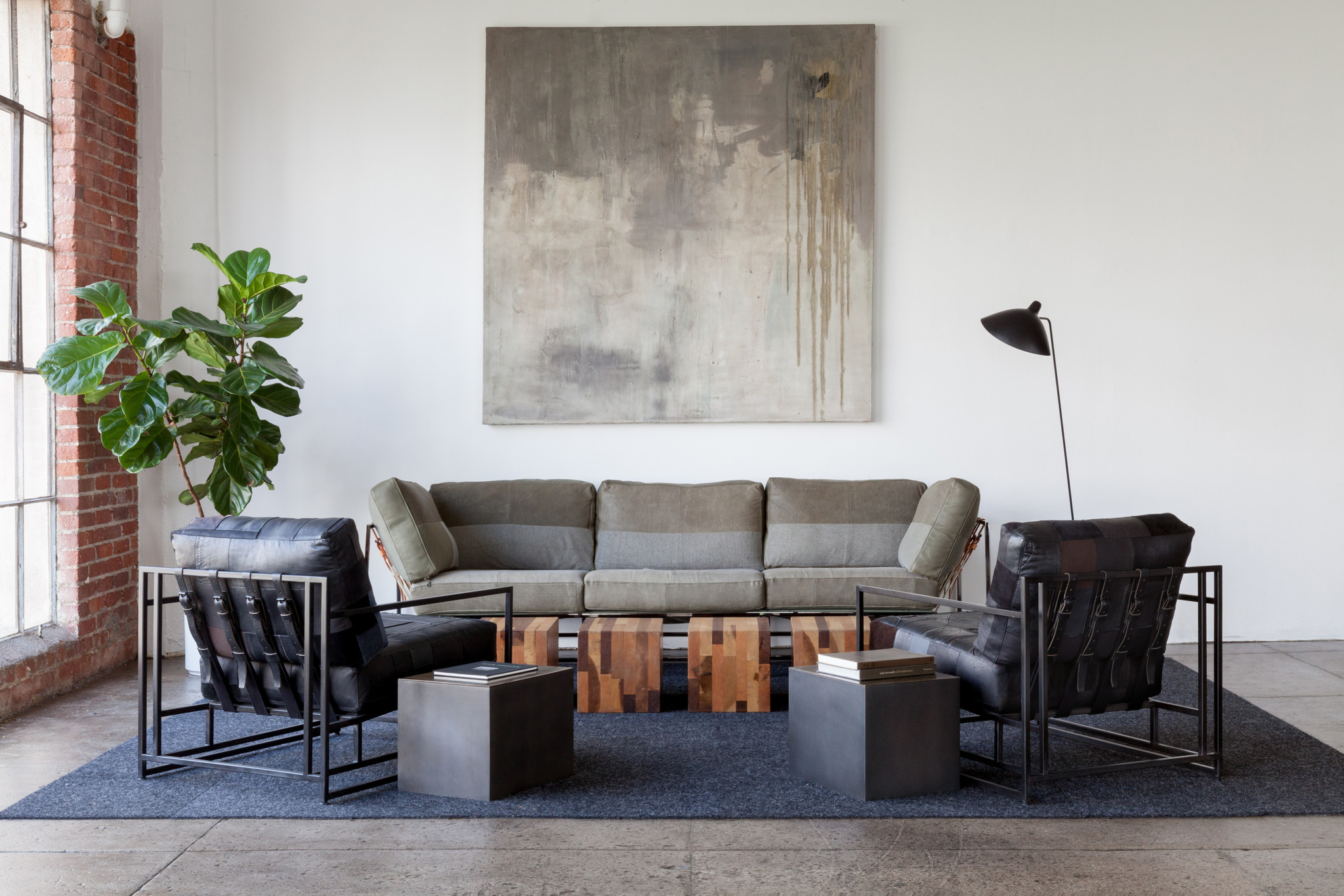 Fashion and furniture partnership upcycles sweats into sofas, biker ...