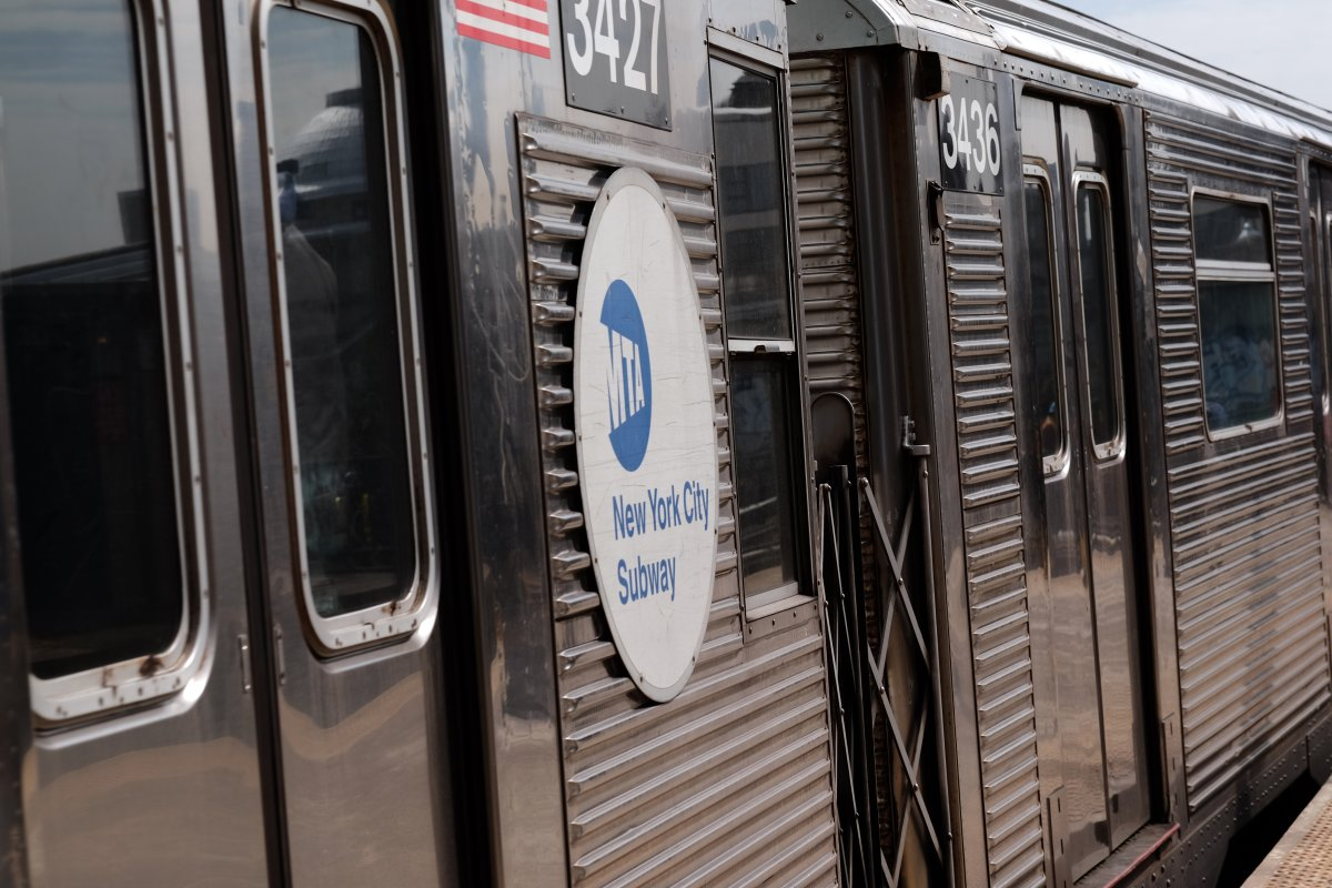 Man spewing hate on Brooklyn subway punches