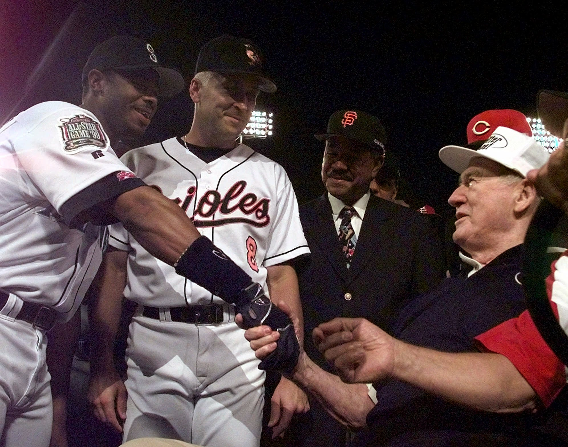 Baseball legend Ted Williams, right, is greeted by 1999 All-Stars Ken Griffey Jr., of the Seattle Mariners, left, and Baltimore Orioles' Cal Ripken prior to the All-Star game Tuesday, July 13, 1999 at Boston's Fenway Park.